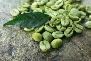 bigstock-Heap-of-green-coffee-beans-wit-98632694-840x560